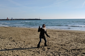 Mom at the beach in Italy