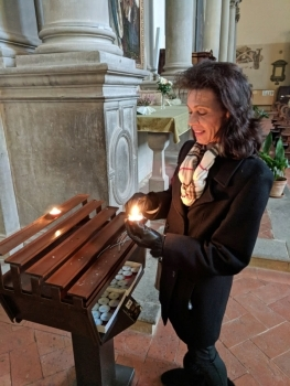 Mom lighting candles in Italian Churches