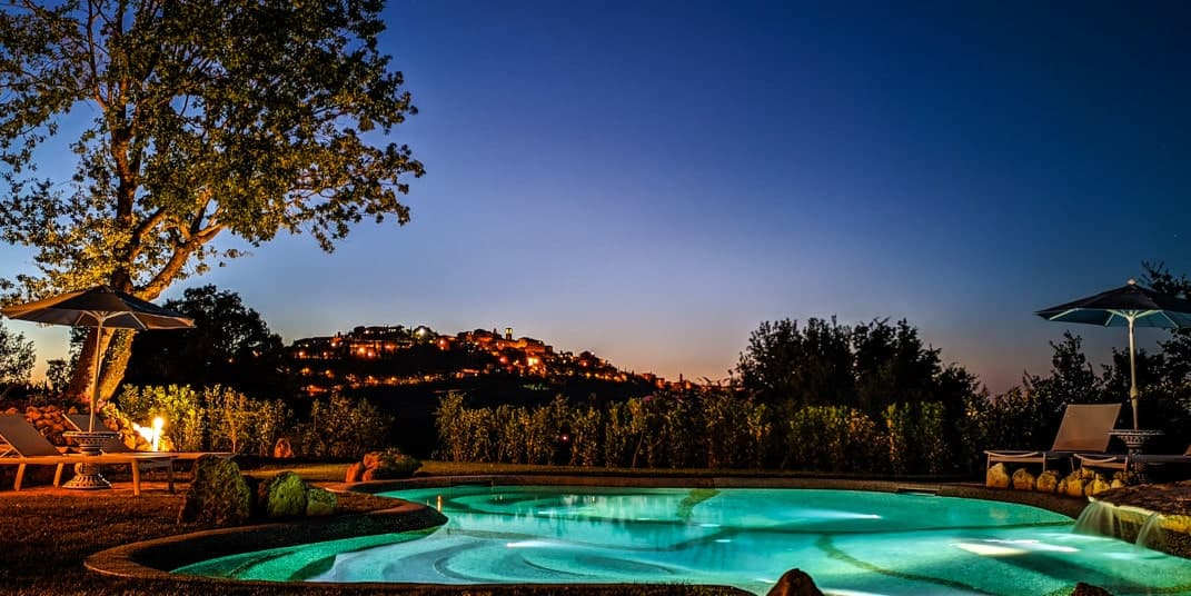nighttime view of montepulciano tuscany bed and breakfast with pool